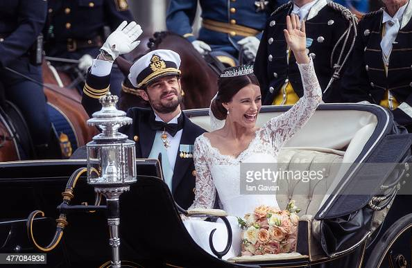 Prince Carl Philip of Sweden and his wife Princess Sofia of Sweden ride in the wedding cortege after their marriage ceremony on June 13 2015 in...