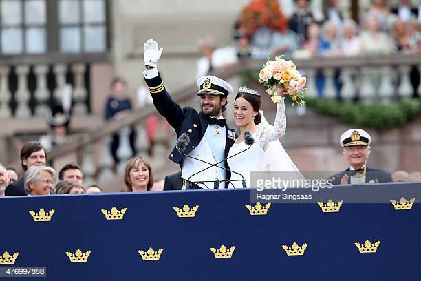 Prince Carl Philip of Sweden and HRH Princess Sofia Duchess of Varmland ride in the wedding cortege after their marriage ceremony on June 13 2015 in...