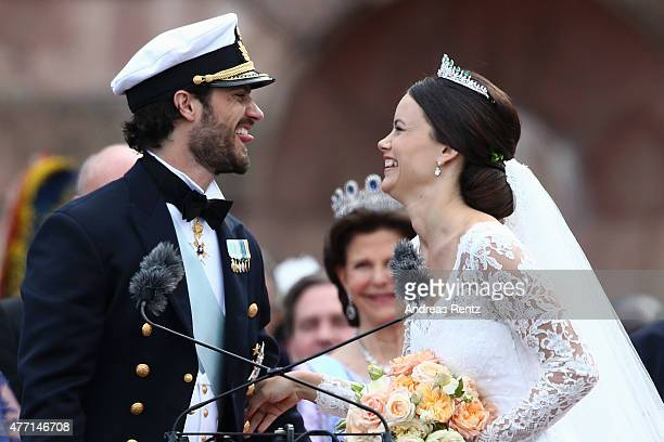 Prince Carl Philip of Sweden and Princess Sofia Duchess of Varmlands salute the crowd after their marriage ceremony on June 13 2015 in Stockholm...