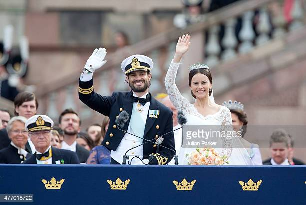 Prince Carl Philip of Sweden and Princess Sofia of Sweden greet crowds at Royal Palace after their wedding on June 13 2015 in Stockholm Sweden