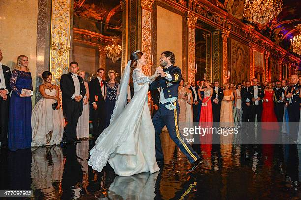 Prince Carl Philip of Sweden dances with his new wife Princess Sofia of Sweden at their marriage ceremony at The Royal Palace on June 13 2015 in...