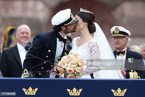 Prince Carl Philip of Sweden kisses Princess Sofia Duchess of Varmlands after their marriage ceremony on June 13 2015 in Stockholm Sweden