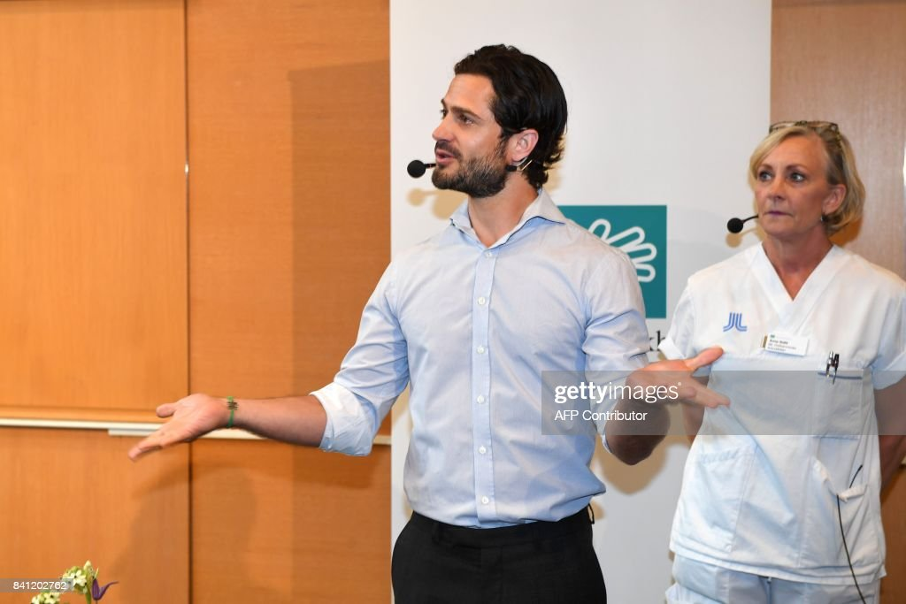 Prince Carl Philip of Sweden (L) meets the media at the Danderyds hospital in North Stockholm where Princess Sofia (unseen) gave birth to a son on August 31, 2017. News Agency / Fredrik SANDBERG / Sweden OUT