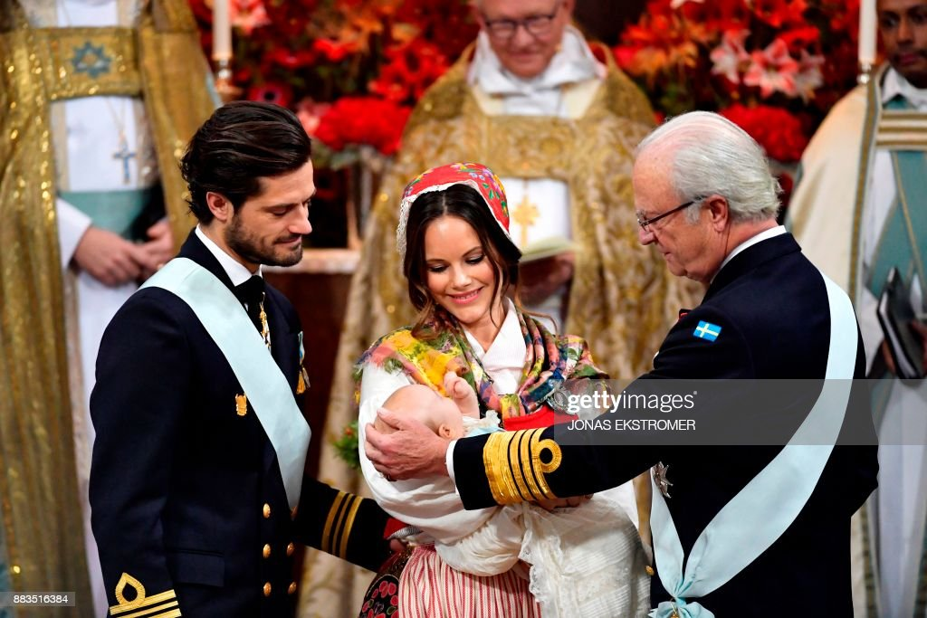Prince Carl Philip, princess Sofia and King Carl Gustaf of Sweden attend to baby with prince Gabriel during his christening in Drottningholm Palace Chapel outside Stockholm, 1 December, 2017. Prince Gabriel is the second son of Prince Carl Philip and Princess Sofia of Sweden. / AFP PHOTO / TT News Agency / Jonas EKSTROMER / Sweden OUT