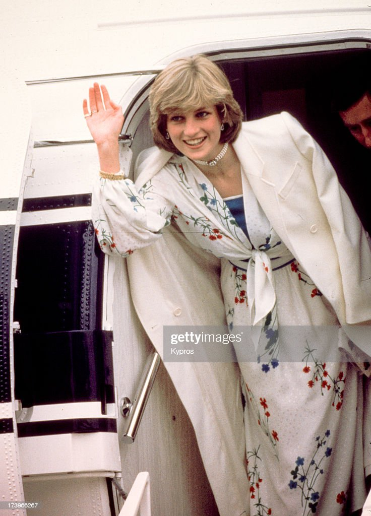Prince Charles and Diana, Princess of Wales (1961 - 1997) leave Eastleigh airport in Hampshire at the start of their honeymoon, August 1981. She is wearing a Donald Campbell dress.