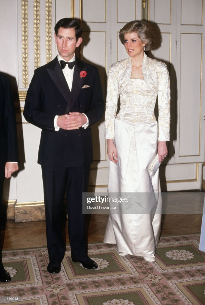 <a gi-track='captionPersonalityLinkClicked' href=/galleries/search?phrase=Prince+Charles&family=editorial&specificpeople=160180 ng-click='$event.stopPropagation()'>Prince Charles</a> and Diana Princess of Wales meet guests arriving at a dinner in the Elysee Palace in Paris, France in November 1988, during the Royal Tour of France. Diana wore a dress designed by Victor Edelstein.