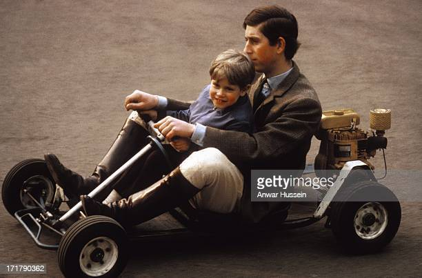 Prince Charles and his youngest brother Prince Edward go for a spin in their gokart on the grounds of Windsor Castle in May 1969 near Windsor...