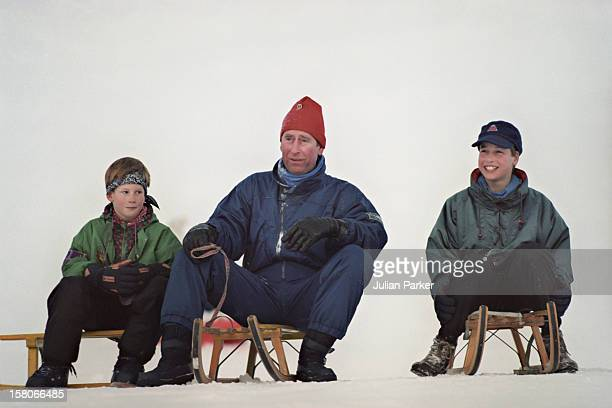 Prince Charles And Prince Harry And Prince William Sledging During A Ski Holiday In Klosters Switzerland