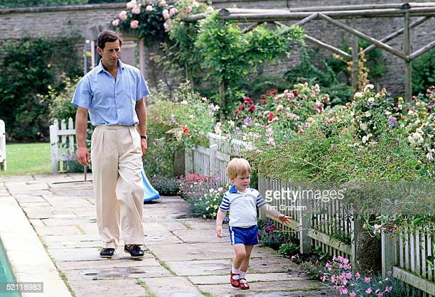 Prince Charles And Prince Harry By The Swimming Pool In The Garden At Their Home Highgrove House