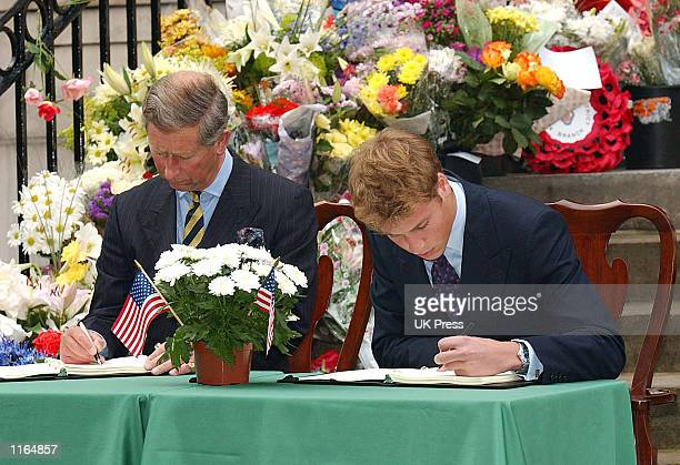 Prince Charles and Prince William sign books of condolence for the victims of the recent terrorist attacks in America September 21 2001 in front of...