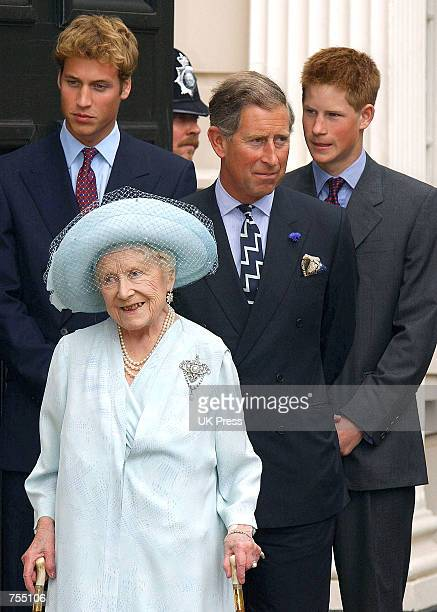 Prince Charles and Princes William and Harry stand next to the Queen Mother as she stands outside Clarence House on the occassion of her 101st...