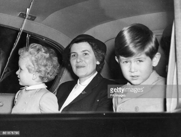 Prince Charles and Princess Anne look out at the London crowds as they left Buckingham Palace for Euston Station to leave on a night train trip to...