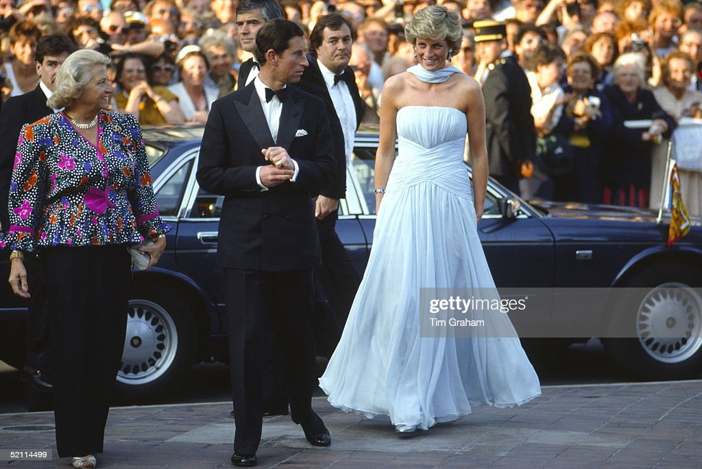 Prince Charles And Princess Diana Arriving At The Cannes Film Festival For A Gala Night In Honour Of Actor Sir Alec Guinness. The Princess Is Wearing A Pale Blue Silk Chiffon Strapless Dress With A Matching Chiffon Stole Designed By Fashion Designer Catherine Walker. They Are Greeted By The Lady Mayor Of Cannes.