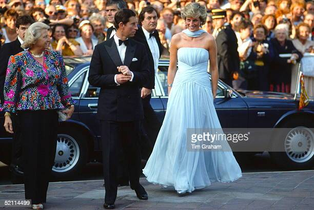 Prince Charles And Princess Diana Arriving At The Cannes Film Festival For A Gala Night In Honour Of Actor Sir Alec Guinness The Princess Is Wearing...