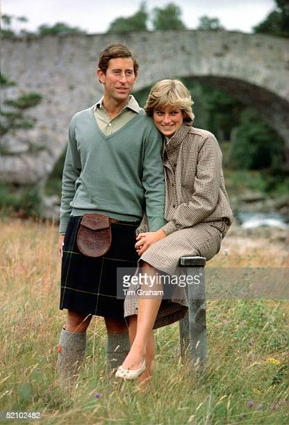 Prince Charles And Princess Diana Holding Hands And Smiling As They Pose During A Honeymoon Photocall By The River Dee The Princess Is Wearing A...