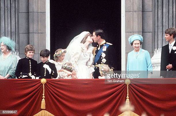 Prince Charles And Princess Diana Kissing On The Balcony Of Buckingham Palace They Are Surrounded By Their Bridesmaids And Pageboys As Well As Queen...