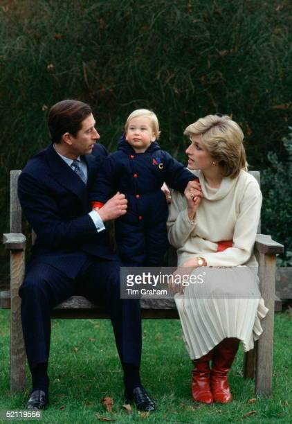 Prince Charles And Princess Diana Sitting On A Bench For A Photocall With Their Son Prince William In Their Garden At Kensington Palace
