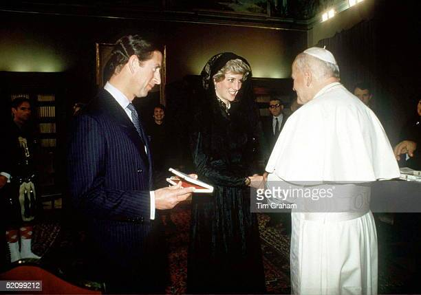 Prince Charles And Princess Diana Wearing Traditional Black Mantilla Veil Visiting Pope Johnpaul II At The Vatican During Their Tour Of Italy