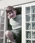 Prince Charles at a window in the little Welsh cottage at the Royal Lodge in Windsor in England on 7 April 1954