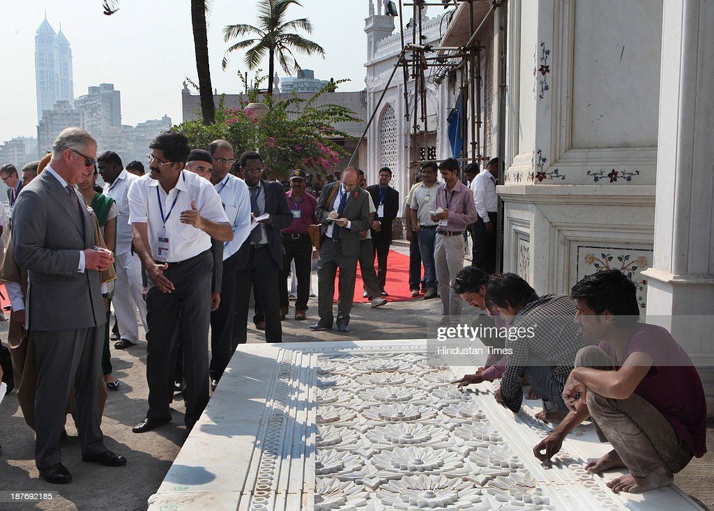 Prince Charles being briefed about the restoration work on the monument during his visit at the Haji Ali Dargah, Mahalaxmi on November 11, 2013 in Mumbai, India. Haji Ali shrine is the resting abode of the Muslim saint Pir Haji Ali Shah Bukhari and is situated a few hundred meters ahead of the shoreline of the Arabian Sea. Prince Charles is on a nine-day-visit to the country with his wife, the Duchess of Cornwall, Camilla before leaving for Sri Lanka to attend the Commonwealth Heads of Government Meeting in Colombo.
