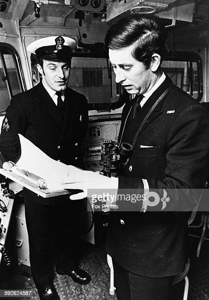 Prince Charles checking a weather report on the bridge of the frigate ship HMS Minerva where he is serving as SubLieutenant February 12th 1973