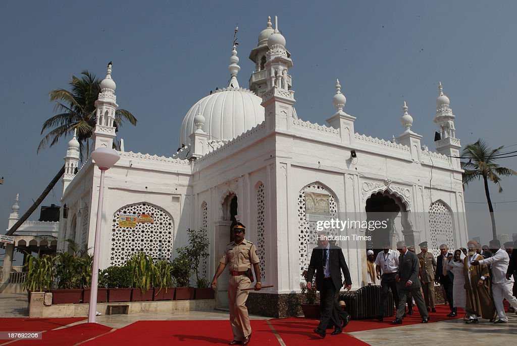 Prince Charles coming out during his visit at the Haji Ali Dargah, Mahalaxmi on November 11, 2013 in Mumbai, India. Haji Ali shrine is the resting abode of the Muslim saint Pir Haji Ali Shah Bukhari and is situated a few hundred meters ahead of the shoreline of the Arabian Sea. Prince Charles is on a nine-day-visit to the country with his wife, the Duchess of Cornwall, Camilla before leaving for Sri Lanka to attend the Commonwealth Heads of Government Meeting in Colombo.