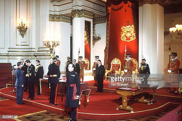 Prince Charles Conducting An Investiture In The Throne Room At Buckingham Palace With Him In Attendance Are Yeomen Of The Guard In The Throne Room