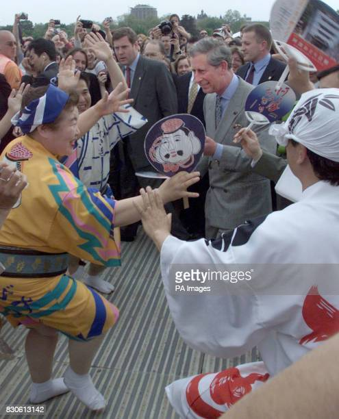 Prince Charles dances with traditional Japanese dancers as he visits the Festival of Japan in London Prince Charles visited the festival with Japan...