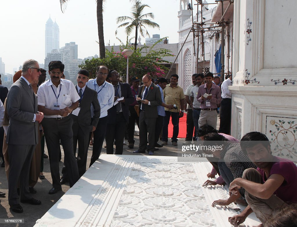 Prince Charles discussing the intricacies of the marble carvings, a very Indian art, with the Rajasthani artists, while giving final touch to the renovation work at the Haji Ali Dargah, Mahalaxmi on November 11, 2013 in Mumbai, India. Haji Ali shrine is the resting abode of the Muslim saint Pir Haji Ali Shah Bukhari and is situated a few hundred meters ahead of the shoreline of the Arabian Sea. Prince Charles is on a nine-day-visit to the country with his wife, the Duchess of Cornwall, Camilla before leaving for Sri Lanka to attend the Commonwealth Heads of Government Meeting in Colombo.
