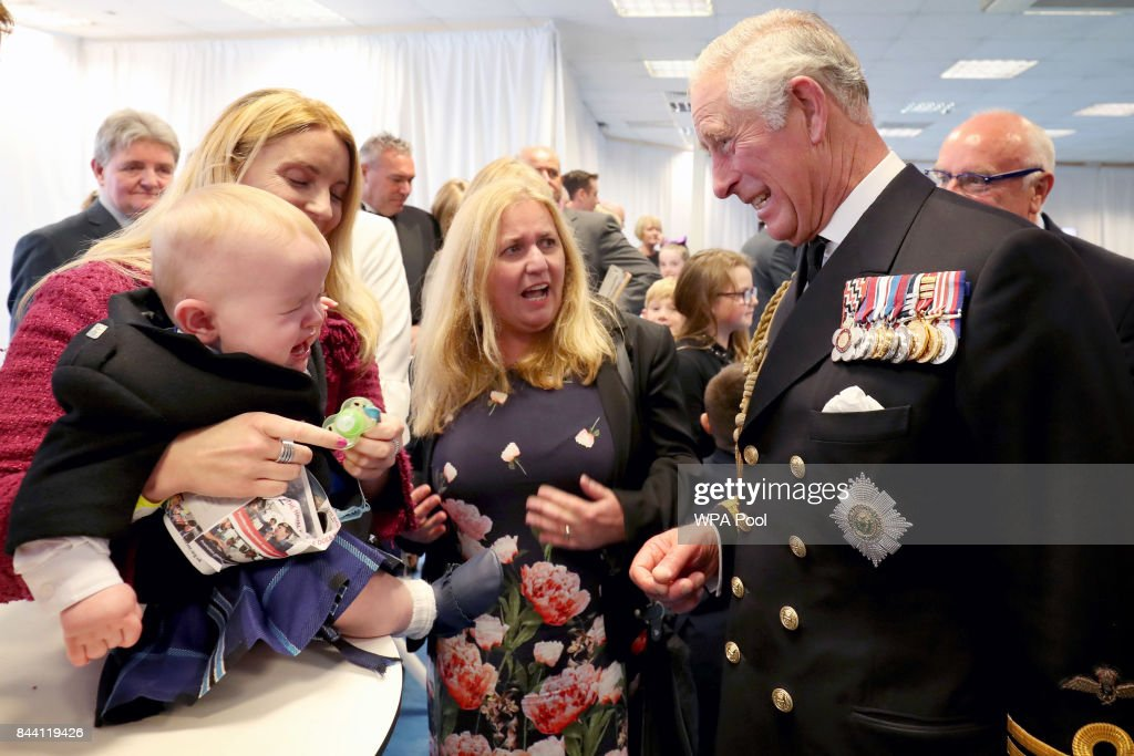 Prince Charles, Duke of Rothesay meets 11 month old Myles Johnston at a reception following the naming ceremony for the HMS Prince of Wales aircraft carrier at the Royal Dockyard on September 8, 2017 in Rosyth, Scotland.