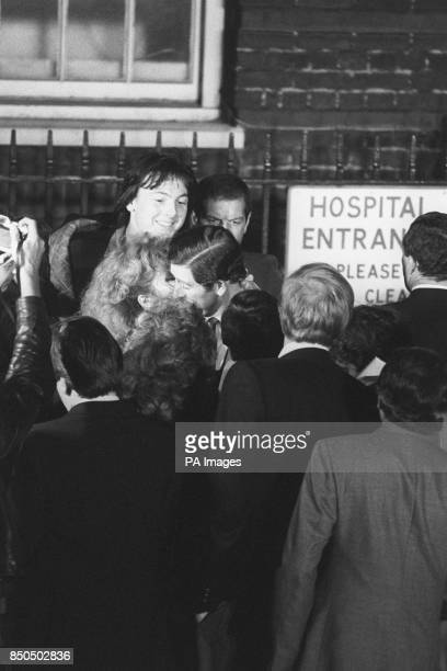 Prince Charles getting a celebratory kiss from Diana Redding a 32yearold singer and songwriter as he leaves St Mary's Hospital in Paddington London...