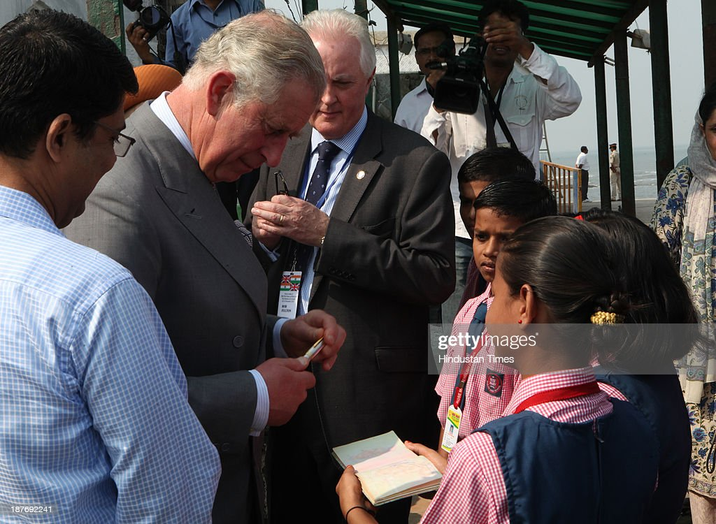 Prince Charles giving his autograph to school children during his visit at the Haji Ali Dargah, Mahalaxmi on November 11, 2013 in Mumbai, India. Haji Ali shrine is the resting abode of the Muslim saint Pir Haji Ali Shah Bukhari and is situated a few hundred meters ahead of the shoreline of the Arabian Sea. Prince Charles is on a nine-day-visit to the country with his wife, the Duchess of Cornwall, Camilla before leaving for Sri Lanka to attend the Commonwealth Heads of Government Meeting in Colombo.