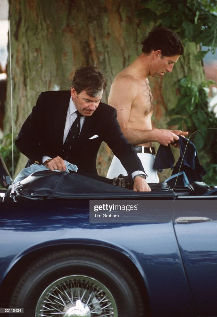 prince-charles-helped-by-his-valet-ken-stronach-circa-1980s-while-picture-id52115434