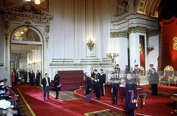 Prince Charles Holding An Investiture At Buckingham Palace