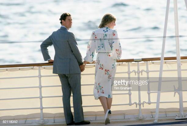 Prince Charles Holding Princess Diana's Hand At The Rail Of The Royal Yacht Britannia At The Start Of Their Honeymoon Cruiseher Outfit Designed By...