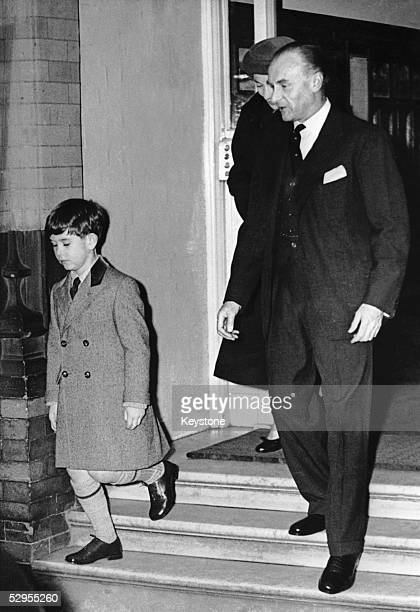 Prince Charles is escorted to a Ford Zephyr by the headmaster of Hill House School in Knightsbridge and his governess Catherine Peebles 29th January...
