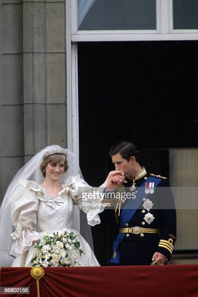 Prince Charles kisses the hand of his new bride Princess Diana on the balcony of Buckingham Palace on their wedding day