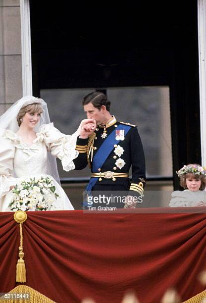 Prince Charles Kisses The Hand Of His New Wife Diana Princess Of Wales On The Balcony Of Buckingham Palace She Is Wearing A Wedding Dress Designed By...