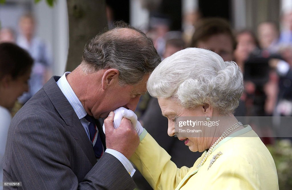 Prince Charles Kissing The Hand Of His Mother Queen Elizabeth When They Met At The Chelsea Flower Show.