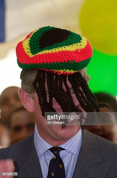Prince Charles Models A Wool Hat Known As A Rastafarian Tam Presented To Him By Rita Marley During His Visit To Trenchtown The Home Of Reggae Music...