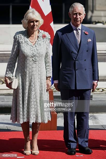 Prince Charles of Wales and his wife Camilla Duchess of Cornwall pose during a reception by Mexican President Enrique Pena Nieto at the National...