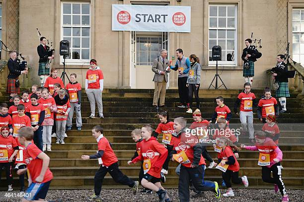 Prince Charles officially starts The Dumfries House Sport Relief Mile on January 21 2014 in CummnockScotland Children from local primary and...