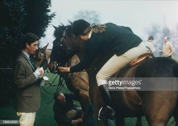 Prince Charles pictured holding a jar of sugar lumps as his sister Princess Anne feeds one to her horse during filming of the television documentary...