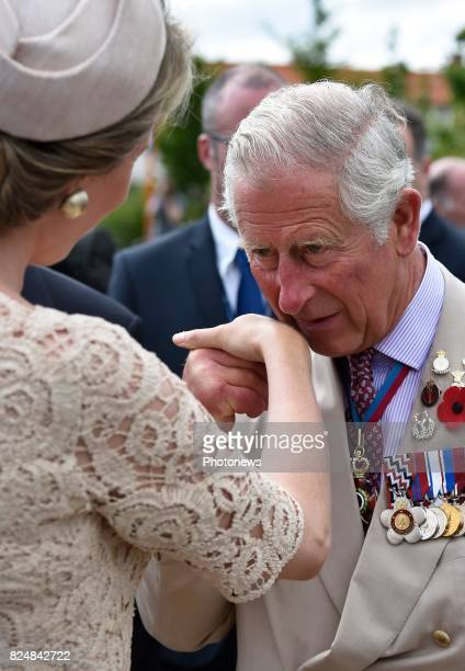 Prince Charles pictured kissing the hand of Queen Mathilde during the Passchendaele commemorations