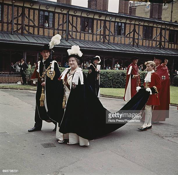 Prince Charles pictured walking in procession with his grandmother Queen Elizabeth The Queen Mother after being invested and installed with the Most...