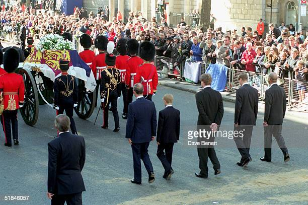 Prince Charles Prince Harry Earl Spencer Prince William and Prince Philip Duke of Edinburgh follow the coffin of Diana The Princess of Wales towards...