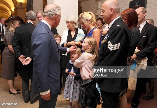 Prince Charles Prince of Walemeets the family of fallen police officer Dave Phillips after the the National Police Memorial Service at St Paul's...