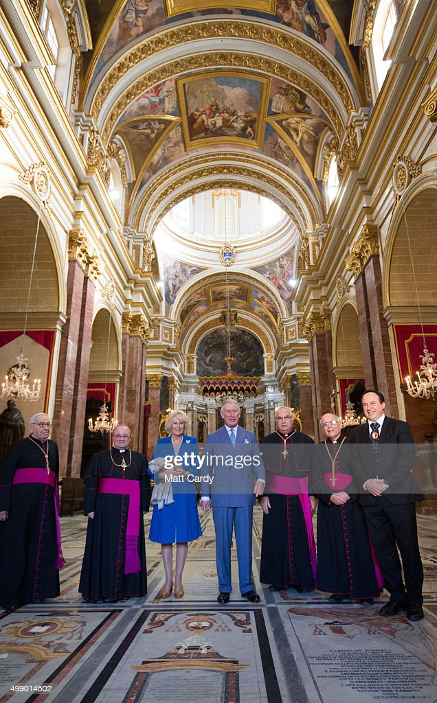 Prince Charles, Prince of Wales accompanied by Camilla, Duchess of Cornwall pose for a photograph inside the cathedral as they take a walking tour of the old town of Mdina in central Malta on November 28, 2015 near Valletta, Malta. Queen Elizabeth II, The Duke of Edinburgh, Prince Charles, Prince of Wales and Camilla, Duchess of Cornwall arrived in Malta are on their final day of a visit to the island that has been hosting the Commonwealth Heads of State Summit.