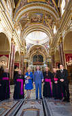 Prince Charles Prince of Wales accompanied by Camilla Duchess of Cornwall pose for a photograph inside the cathedral as they take a walking tour of...