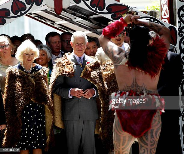 Prince Charles Prince of Wales and Camilla Duchess of Cornwall receive a 'Powhiri' maori challege on their arrival at Turangawaewae Marae on November...